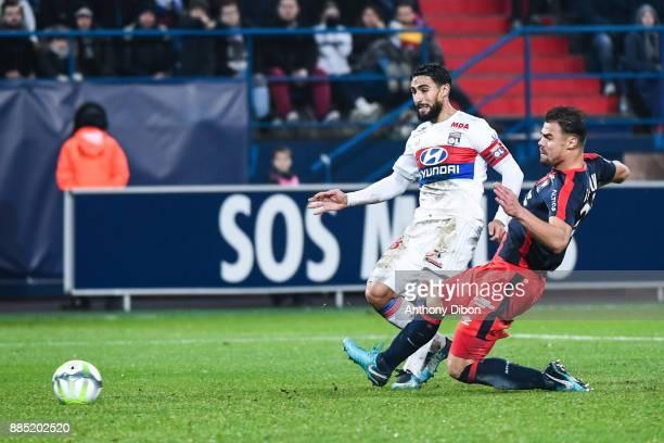 Nabil Fekir of Lyon and Damien Da Silva of Caen during the Ligue 1 match between SM Caen and Olympique Lyonnais at Stade Michel D'Ornano on December...