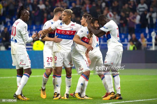 Nabil Fekir of Lyon and Ferland Mendy of Lyon react after scoring during the Ligue 1 match between Olympique Lyonnais and AS Monaco at Stade des...