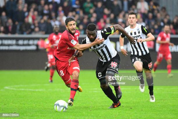 Nabil Fekir of Lyon and Ismael Traore of Angers during the Ligue 1 match between Angers SCO and Olympique Lyonnais at Stade Raymond Kopa on October 1...