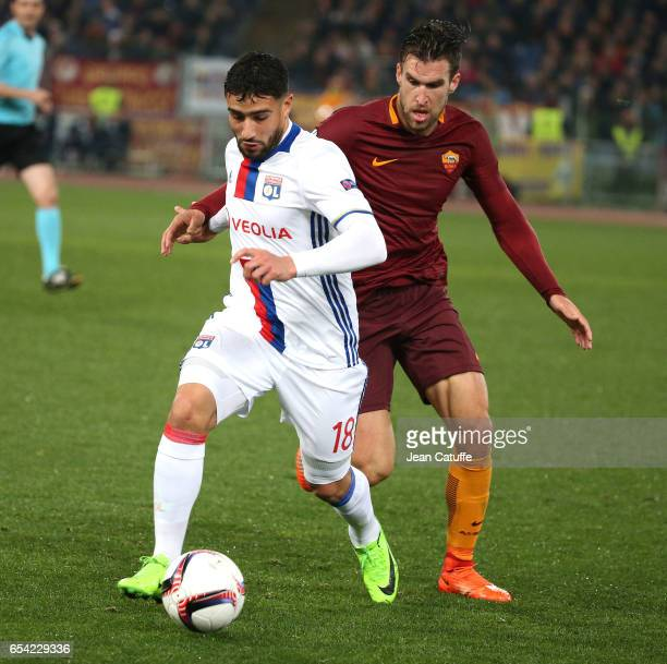 Nabil Fekir of Lyon and Kevin Strootman of AS Roma in action during the UEFA Europa League Round of 16 second leg match between AS Roma and Olympique...