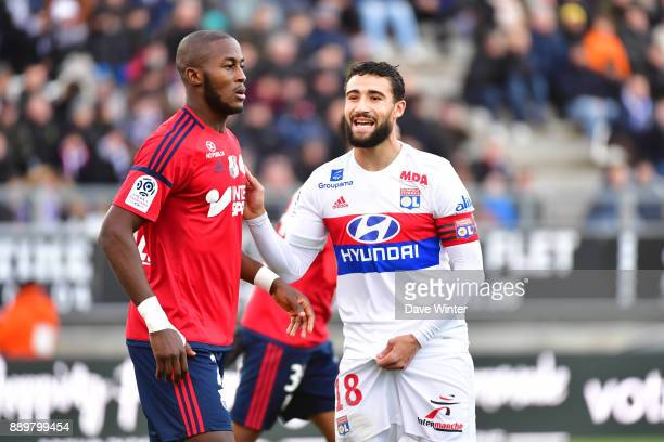 Nabil Fekir of Lyon and Khaled Adenon of Amiens during the Ligue 1 match between Amiens SC and Olympique Lyonnais at Stade de la Licorne on December...