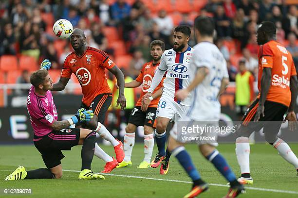 Nabil Fekir of Lyon and Michael Ciani and Benjamin Lecomte of Lorient during the Ligue 1 match between FC Lorient and Olympique Lyonnais at Stade du...