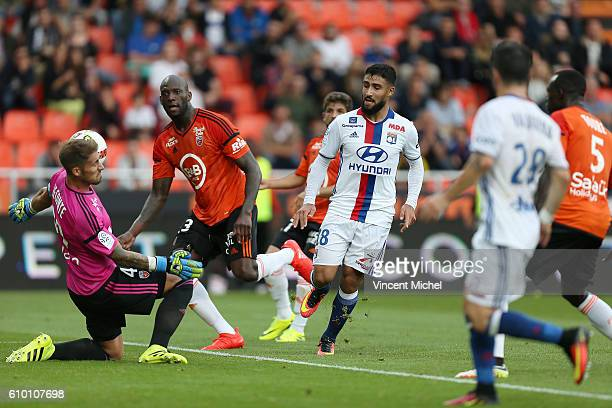 Nabil Fekir of Lyon and Mickael Ciani and Benjamin Lecomte of Lorient during the Ligue 1 match between FC Lorient and Olympique Lyonnais at Stade du...