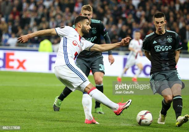 Nabil Fekir of Lyon and Nick Viergever of Ajax Amsterdam during the UEFA Europa League semi final second leg match between Olympique Lyonnais and...