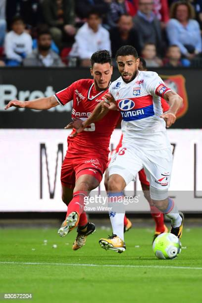 Nabil Fekir of Lyon and Ramy Bensebaini of Rennes during the Ligue 1 match between Stade Rennais and Olympique Lyonnais at Roazhon Park on August 11...
