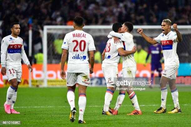 Nabil Fekir of Lyon celebrates after scoring with Houssem Aouar of Lyon during the Ligue 1 match between Olympique Lyonnais and AS Monaco at Stade...