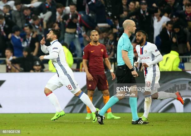 Nabil Fekir of Lyon celebrates his goal with Alexandre Lacazette during the UEFA Europa League Round of 16 first leg match between Olympique Lyonnais...