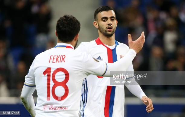 Nabil Fekir of Lyon celebrates his goal with Rachid Ghezzal in action during the UEFA Europa League Round of 32 second leg match between Olympique...