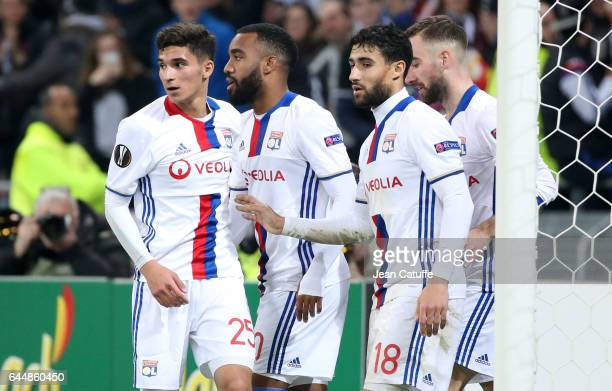 Nabil Fekir of Lyon celebrates his third goal with Houssem Aouar Alexandre Lacazette during the UEFA Europa League Round of 32 second leg match...