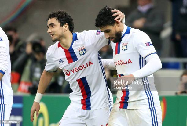 Nabil Fekir of Lyon celebrates his third goal with Rafael da Silva during the UEFA Europa League Round of 32 second leg match between Olympique...