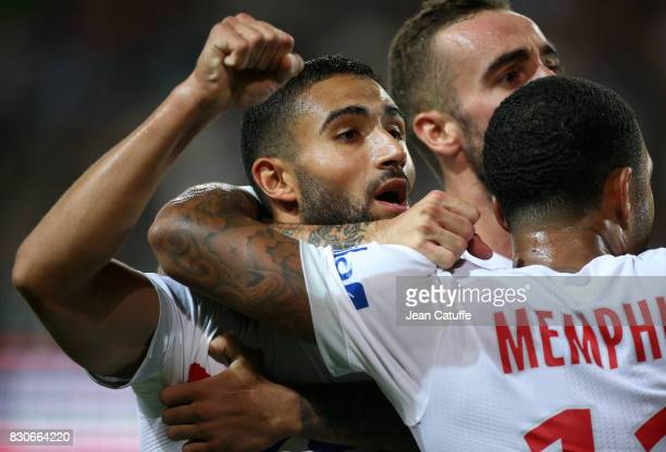 Nabil Fekir of Lyon celebrates the goal of Mariano Diaz during the French Ligue 1 match between Stade Rennais and Olympique Lyonnais at Roazhon Park...