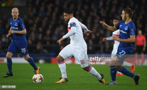 Nabil Fekir of Lyon evades Nikola Vlasic of Everton during the UEFA Europa League Group E match between Everton FC and Olympique Lyon at Goodison...