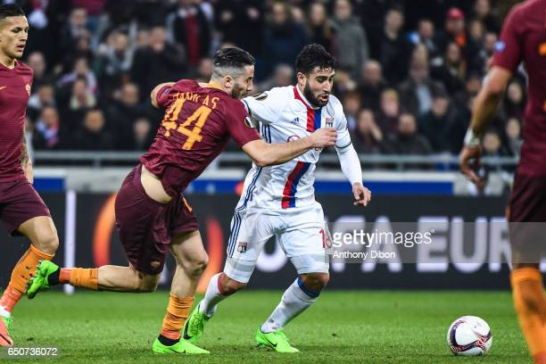Nabil Fekir of Lyon fight for the ball with Manolas Kostas of As Roma during the Uefa Europa League Round of 16 first leg match between Olympique...