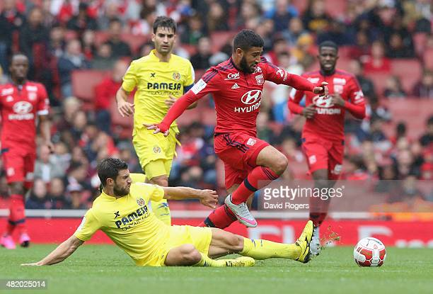 Nabil Fekir of Lyon is tackled by Bojan Jokic during the Emirates Cup match between Olympique Lyonnais and Villarreal at the Emirates Stadium on July...