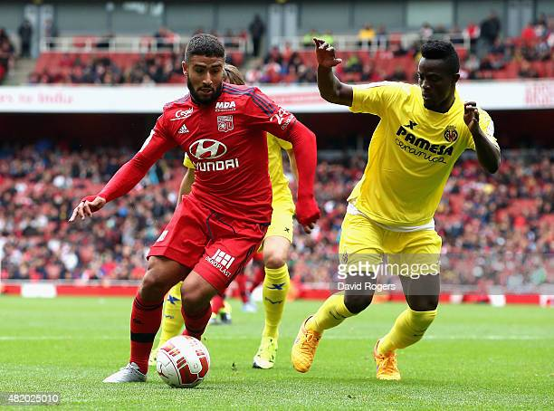 Nabil Fekir of Lyon moves past Eric Bailly during the Emirates Cup match between Olympique Lyonnais and Villarreal at the Emirates Stadium on July 26...
