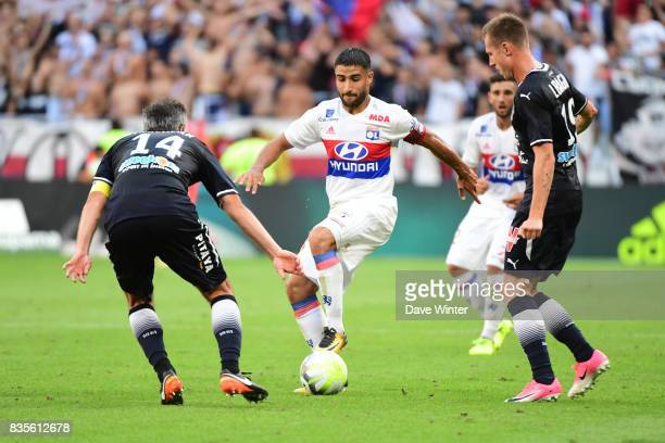 Nabil Fekir of Lyon prepares to take on Jeremy Toulalan of Bordeaux and Lukas Lerager of Bordeaux during the Ligue 1 match between Olympique Lyonnais...