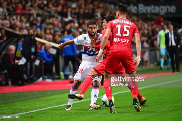 Nabil Fekir of Lyon runs into the Rennes defence during the Ligue 1 match between Stade Rennais and Olympique Lyonnais at Roazhon Park on August 11...