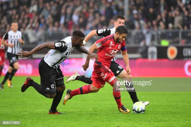 Nabil Fekir of Lyon takes on the Angers defence during the Ligue 1 match between Angers SCO and Olympique Lyonnais at Stade Raymond Kopa on October 1...