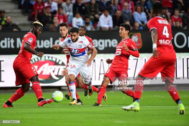 Nabil Fekir of Lyon takes on the Rennes defence during the Ligue 1 match between Stade Rennais and Olympique Lyonnais at Roazhon Park on August 11...