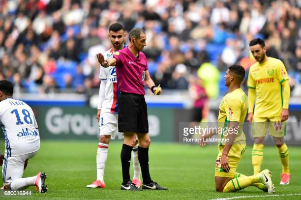 Nabil Fekir of Lyon the referee Mikael Lesage Diego Carlos Santos Silva of Nantes during the Ligue 1 match between Olympique Lyonnais and Fc Nantes...