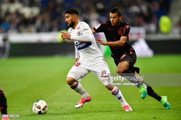 Nabil Fekir of Lyon Younes Belhanda of Nice during the Ligue 1 match between Olympique Lyonnais and OGC Nice at Stade des Lumieres on May 20 2017 in...