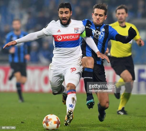 Nabil Fekir of Olympique Lyon competes for the ball whit Rafael Toloi of Atalanta during the UEFA Europa League group E match between Atalanta and...