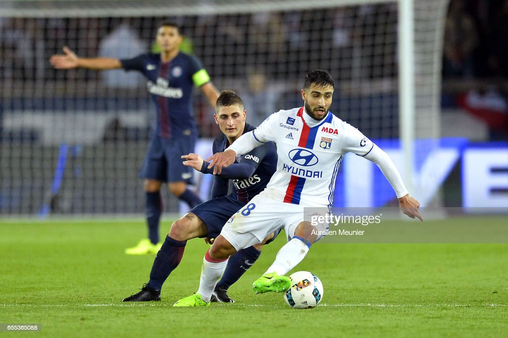 Nabil Fekir of Olympique Lyonnais and Marco Verratti of Paris Saint-Germain fight for the ball during the French Ligue 1 match between Paris Saint Germain and Olympique Lyonnais at Parc des Princes on March 19, 2017 in Paris, France.