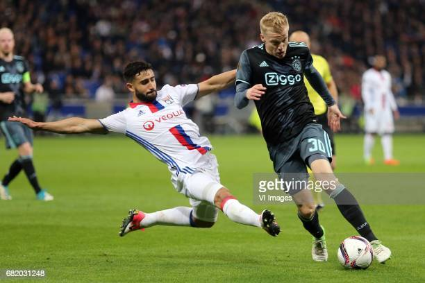 Nabil Fekir of Olympique Lyonnais Donny van de Beek of Ajaxduring the UEFA Europa League semi final match between Olympique Lyonnais and Ajax...