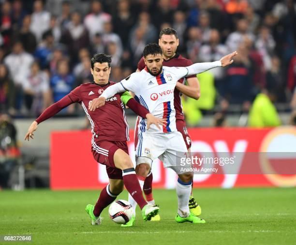 Nabil Fekir of Olympique Lyonnais in action against Necip Uysal of Besiktas during the UEFA Europa League first leg quarter final football match...