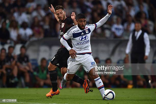 Nabil Fekir of Olympique Lyonnais is challenged by Andrea Bertolacci of AC Milan during the preseason friendly match between Olympique Lyonnais and...