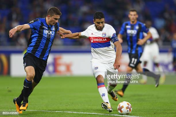 Nabil Fekir of Olympique Lyonnais Lyon holds off Mattia Caldara of Atalanta during the UEFA Europa League group E match between Olympique Lyonnais...