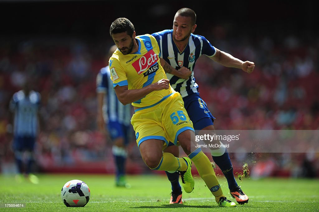 Nabil Ghilas of FC Porto battles with <a gi-track='captionPersonalityLinkClicked' href=/galleries/search?phrase=Alessandro+Gamberini&family=editorial&specificpeople=695639 ng-click='$event.stopPropagation()'>Alessandro Gamberini</a> of Napoli during the Emirates Cup match between Napoli and FC Porto at the Emirates Stadium on August 4, 2013 in London, England.
