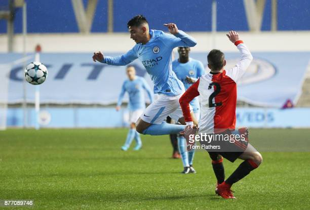 Nabil Touaizi Zoubdi of Manchester City goes past Boyd Reith of Feyenoord during the UEFA Youth League Group F match between Manchester City and...