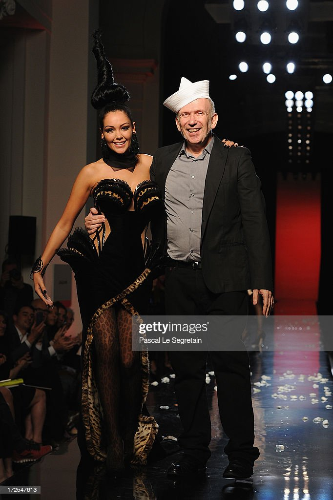 Nabilla Benattia and fashion designer Jean Paul Gaultier walk the runway during the Jean Paul Gaultier show as part of Paris Fashion Week Haute-Couture Fall/Winter 2013-2014 at 325 Rue Saint Martin on July 3, 2013 in Paris, France.