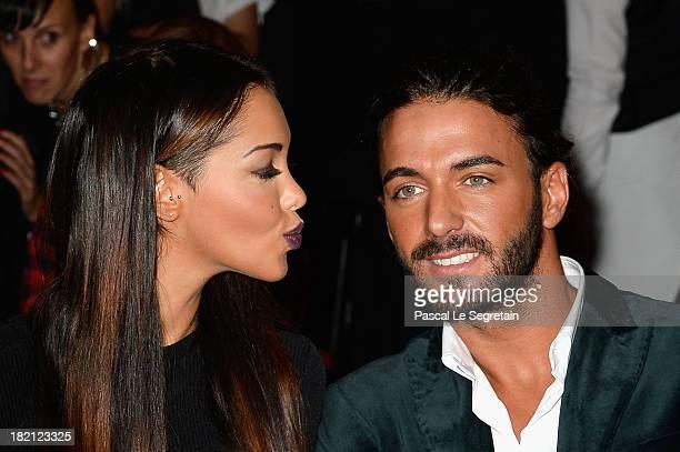 Nabilla Benattia and Thomas Vergara attend the Jean Paul Gaultier show as part of the Paris Fashion Week Womenswear Spring/Summer 2014 at Le Paradis...