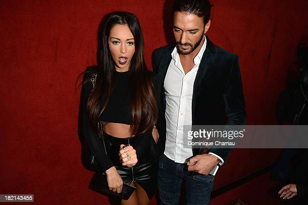Nabilla Benattia and Thomas Vergara attend the Jean Paul Gaultier show as part of the Paris Fashion Week Womenswear Spring/Summer 2014 on September...