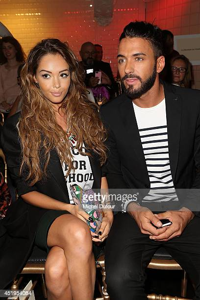 Nabilla Benattia and Thomas Vergara attend the Jean Paul Gaultier show as part of Paris Fashion Week Haute Couture Fall/Winter 20142015 at 325 Rue...