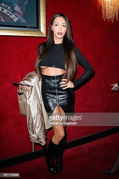 Nabilla Benattia attends the Jean Paul Gaultier show as part of the Paris Fashion Week Womenswear Spring/Summer 2014 at Le Paradis Latin on September...