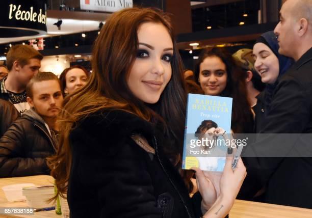 Nabilla Benattia poses with her Book from J'Ai Lu Editions during 'Trop Vite' Nabilla Benattia book signing during Paris Book Fair 2017 at Parc Des...