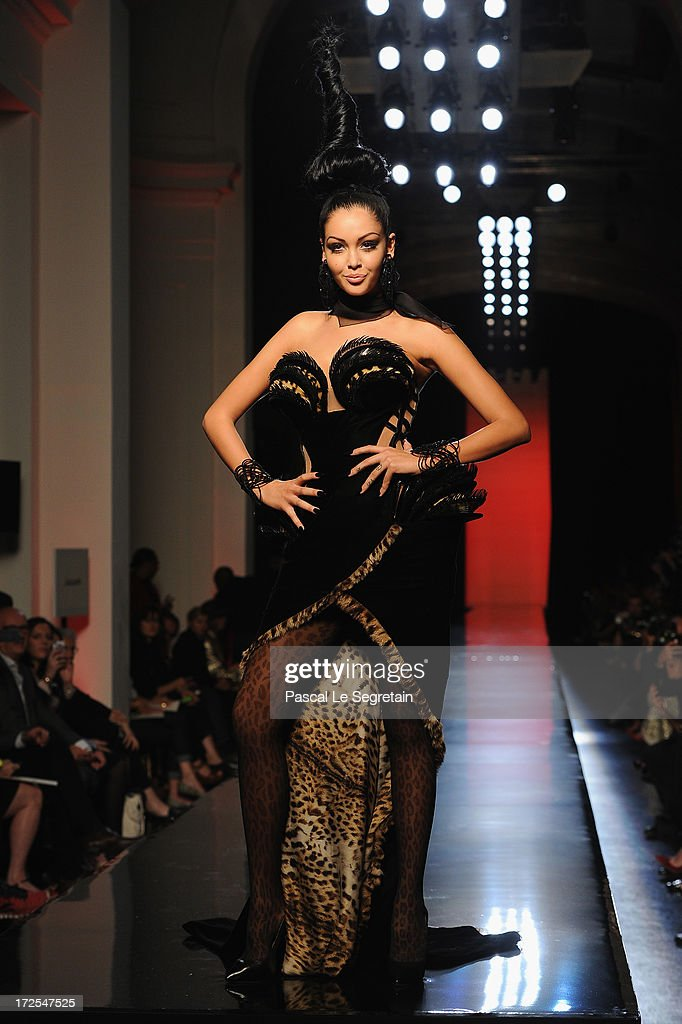 Nabilla Benattia walks the runway during the Jean Paul Gaultier show as part of Paris Fashion Week Haute-Couture Fall/Winter 2013-2014 at 325 Rue Saint Martin on July 3, 2013 in Paris, France.