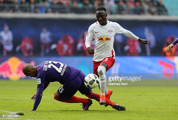Naby Deco Keita of Leipzig battles for the ball with Theodor Gebre Selassie of Bremen during the Bundesliga match between RB Leipzig and SV Werder...