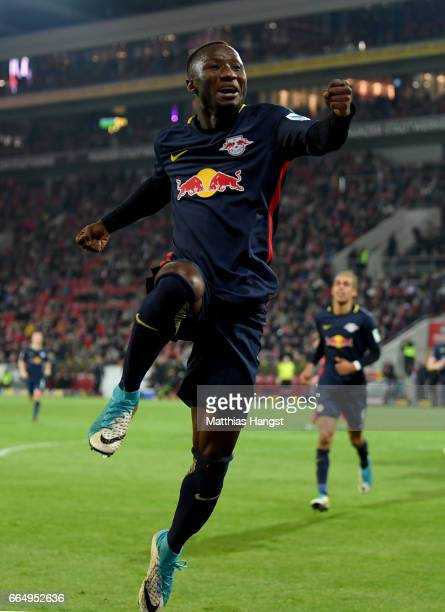 Naby Deco Keita of Leipzig celebrates after he scores his team's 3rd goal during the Bundesliga match between 1 FSV Mainz 05 and RB Leipzig at Opel...