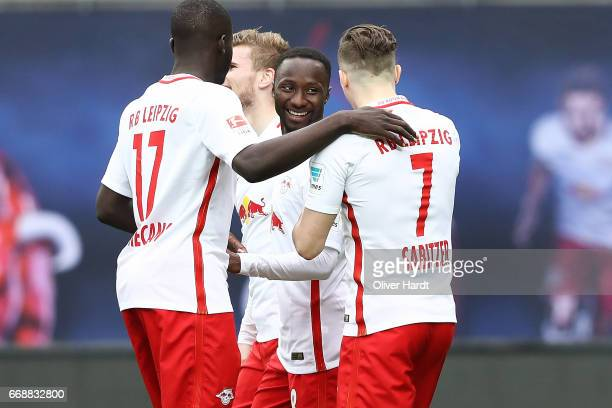 Naby Deco Keita of Leipzig celebrates after scoring their first goal during the Bundesliga match between RB Leipzig and SC Freiburg at Red Bull Arena...