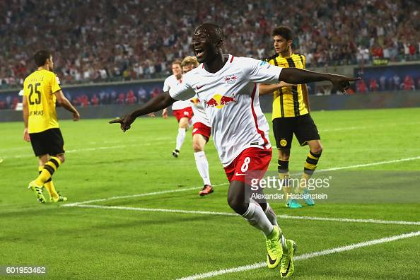 Naby Deco Keita of Leipzig celebrates scoring the first goal during the Bundesliga match between RB Leipzig and Borussia Dortmund at Red Bull Arena...