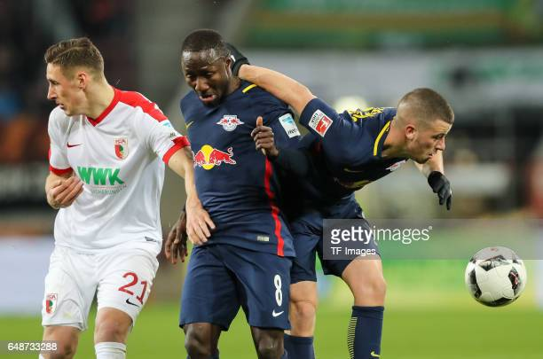 Naby Deco Keita of Leipzig Diego Demme of Leipzig and Dominik Kohr of Augsburg battle for the ball during the Bundesliga match between FC Augsburg...