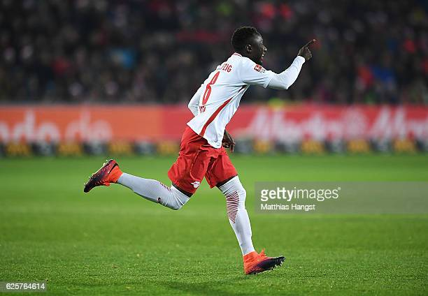 Naby Deco Keita of RB Leipzig celebrates after scoring the first goal during the Bundesliga match between SC Freiburg and RB Leipzig at...