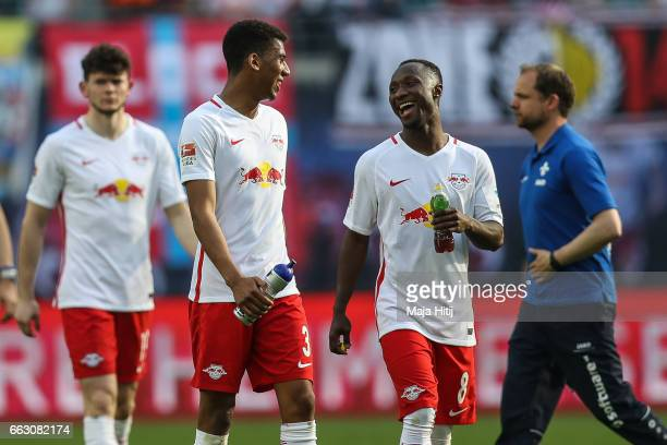 Naby Keita and Bernardo of Leipzig celebrate after the Bundesliga match between RB Leipzig and SV Darmstadt 98 at Red Bull Arena on April 1 2017 in...