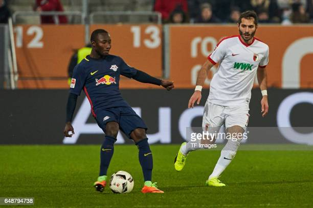 Naby Keita of Leipzig and Halil Altintop of Augsburg battle for the ball during the Bundesliga match between FC Augsburg and RB Leipzig at WWK Arena...