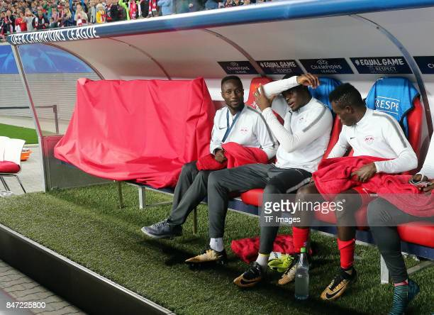 Naby Keita of Leipzig and Yvon Lar Mvogo Nganoma of Lepzig and Bernardo Fernandes da Silva of Leipzig sits on the bench during the UEFA Champions...