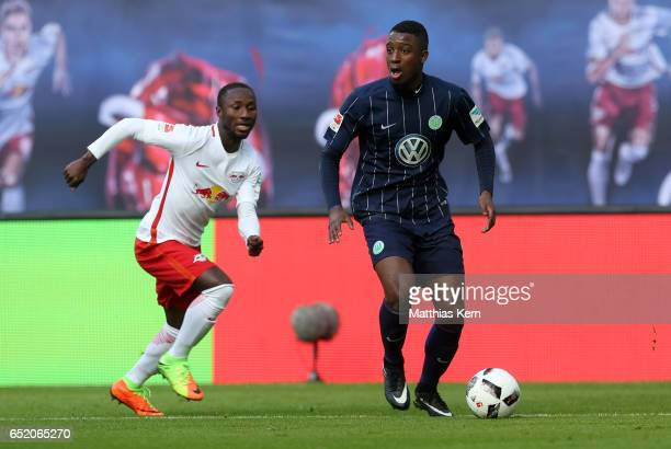 Naby Keita of Leipzig battles for the ball with Riechedly Bazoer of Wolfsburg during the Bundesliga match between RB Leipzig and VfL Wolfsburg at Red...